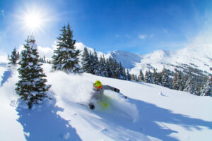 skier riding powder at Loveland Ski Area