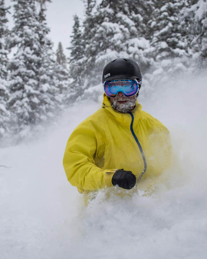 skier in waist high deep powder at Monarch Mountain